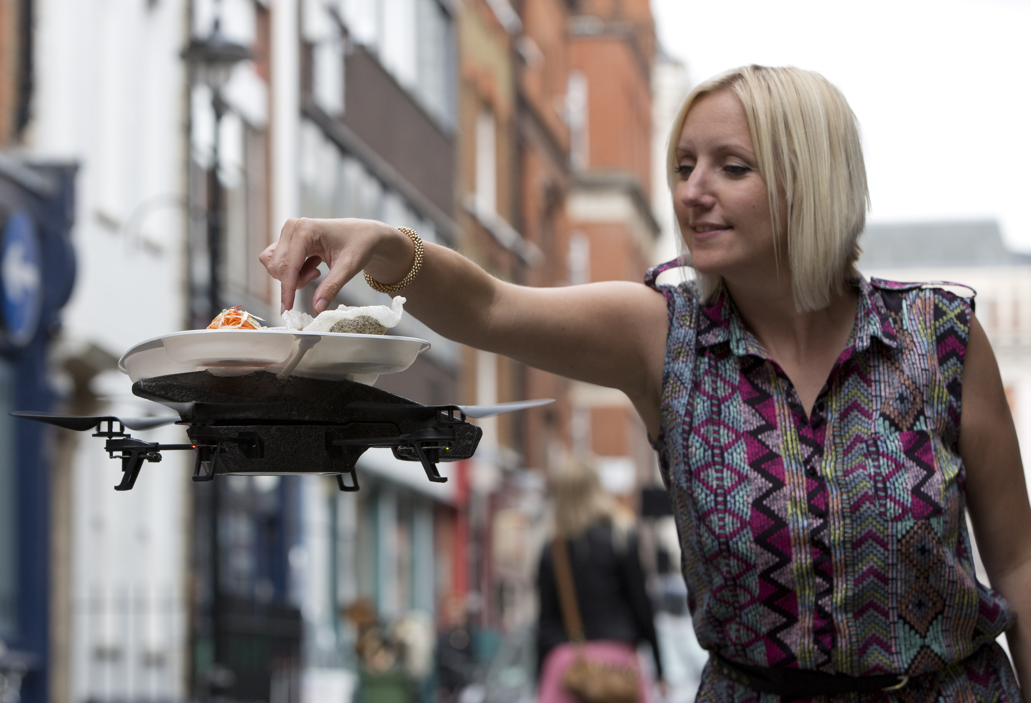 """A flying sushi service tray known as the """"itray"""" is demonstrated at a """"Yo! Sushi"""" restaurant in London"""