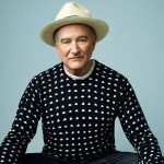 robin-williams-sitting-with-hat-and-sweater-ftr