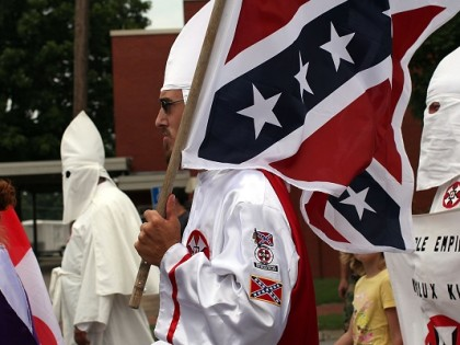PULASKI, TN - JULY 11:  Members of the Fraternal White Knights of the Ku Klux Klan participate in the 11th Annual Nathan Bedford Forrest Birthday march July 11, 2009 in Pulaski, Tennessee. With a poor economy and the first African-American president in office, there has been a rise in extremist activity in many parts of America. According to the Southern Poverty Law Center in 2008 the number of hate groups rose to 926, up 4 percent from 2007, and 54 percent since 2000. Nathan Bedford Forrest was a lieutenant general in the Confederate Army during the American Civil War and played a role in the postwar establishment of the first Ku Klux Klan organization opposing the reconstruction era in the South.  (Photo by Spencer Platt/Getty Images)