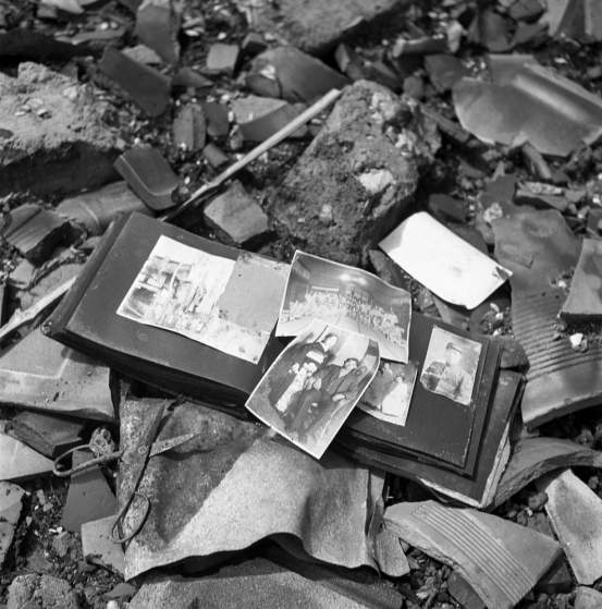 Not published in LIFE. A photo album, pieces of pottery, a pair of scissors Ñ shards of life strewn on the ground in Nagasaki, 1945.