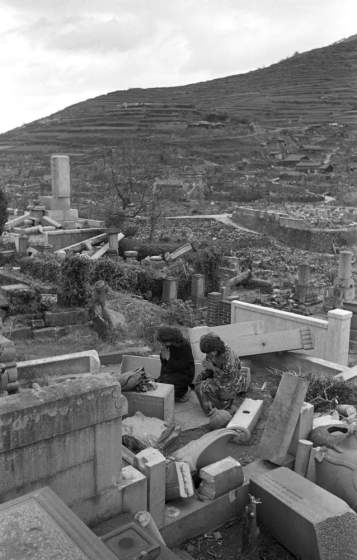 Not published in LIFE. Two women pay respects at a ruined cemetery, Nagasaki, 1945.