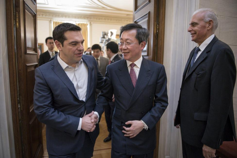 Handout photo of Greek PM Tsipras welcoming China COSCO's chairman Xu Lirong before the signing of the sale of the country's biggest port to shipping giant China COSCO Shipping Corporation at the Maximos Mansion