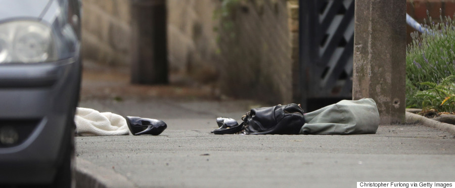 BIRSTALL, ENGLAND - JUNE 16:  A handbag and shoes lie on the ground as police cordon off an area after Jo Cox, 41, Labour MP for Batley and Spen, was shot and stabbed by an attacker at her constituency on June 16, 2016 in Birstall, England. A man also suffered slight injuries during the attack. Jo Cox was reportedly shot and stabbed while holding her weekly surgery at Birstall Library, Birstall near Leeds and remains in a critical condition in hospital.  A 52-year old man has been arrested in connection with the crime.  (Photo by Christopher Furlong/Getty Images)