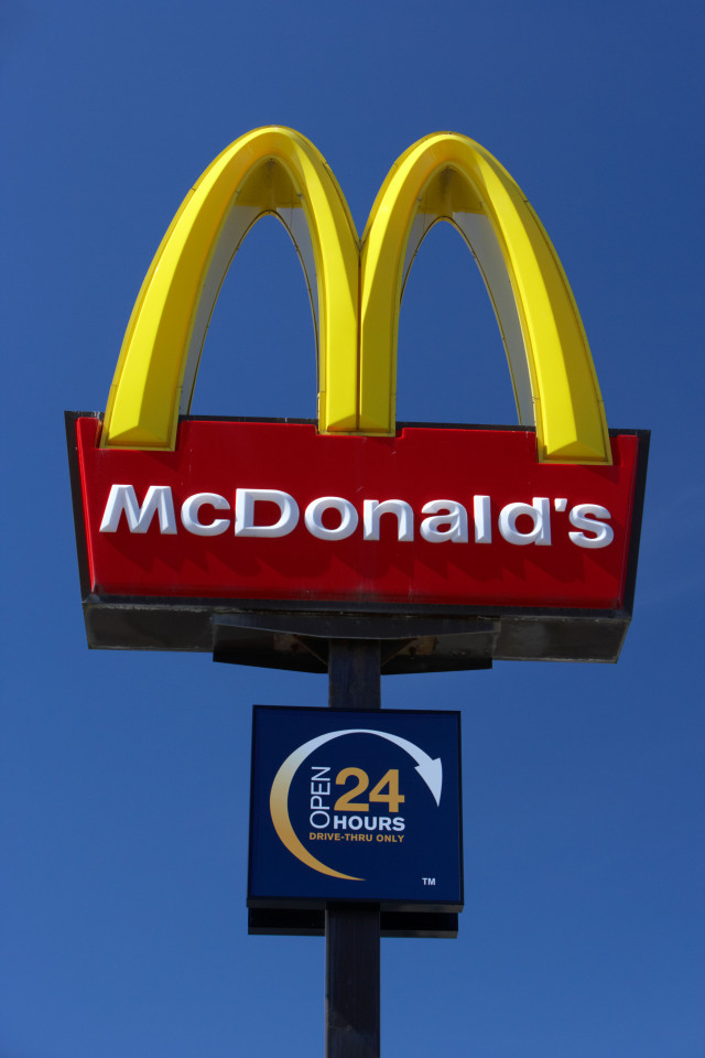BMEDC4 golden arches sign at mcdonalds drive through fast food restaurant merseyside england uk