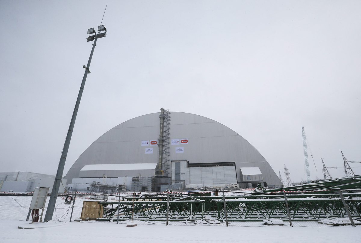 epa05651741 General view of the new protective shelter which placed over the remains of the nuclear reactor Unit 4, at Chernobyl nuclear power plant, in Chernobyl, Ukraine, 29 November 2016. The explosion of Unit 4 of the Chernobyl nuclear power plant in the early hours of 26 April 1986 is still regarded the biggest accident in the history of nuclear power generation. Under extremely hazardous conditions a steel and concrete structure was built hastily immediately after the accident. The new concrete and steel built over the still-radioactive remains of a reactor which was melted down as a result of the accident and has 105 meters tall, 150 meters length with a width of 257 meters and a 100 years life expectancy of the confinement.  EPA/SERGEY DOLZHENKO