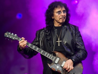 """Veteran rock guitarist Tony Iommi performs on the Apollo stage with """"Heaven and Hell"""" at the Sonisphere rock festival at Knebworth on August 1 2009.  The festival runs over two days and is set to features performances from bands including Metallica, Nine Inch Nails, Anthrax and Bullet for my Valentine. AFP PHOTO/Leon Neal (Photo credit should read Leon Neal/AFP/Getty Images)"""